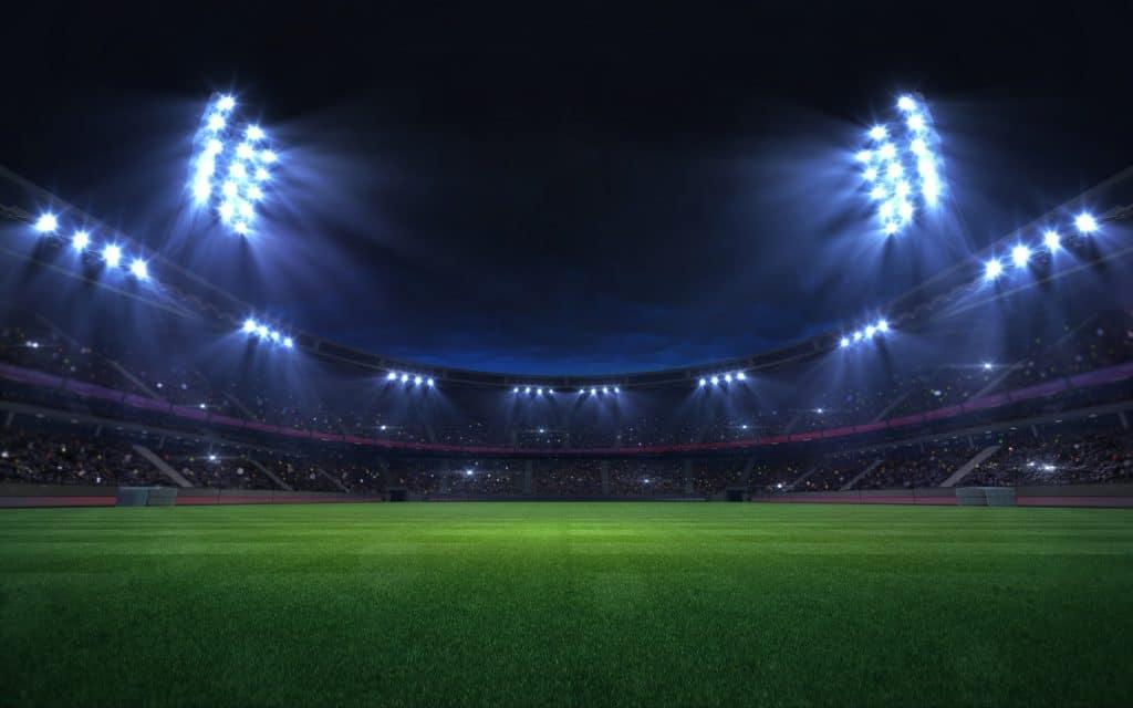 universal grass stadium illuminated by spotlights and empty green grass playground, grand sport building digital 3D background advertisement background illustration